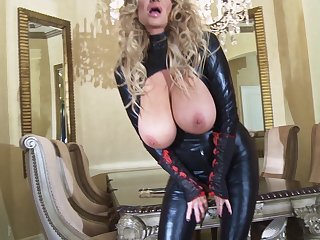 Kelly Madison is a at a high in a latex outfit who loves masturbating