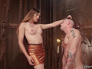 Tranny in latex fucks muscled soldier