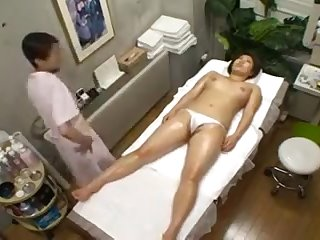Big breasted Oriental hottie with a magnificent ass enjoys