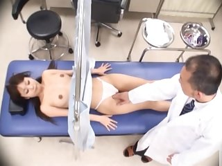 Japanese chick gets her pussy checked out in detail!