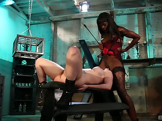 Ebony mistress plays with her waiting upon girl pretty rough