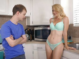 Half naked stepmom Kit Mercer allows to agitate her boobies and gives the best evermore blowjob